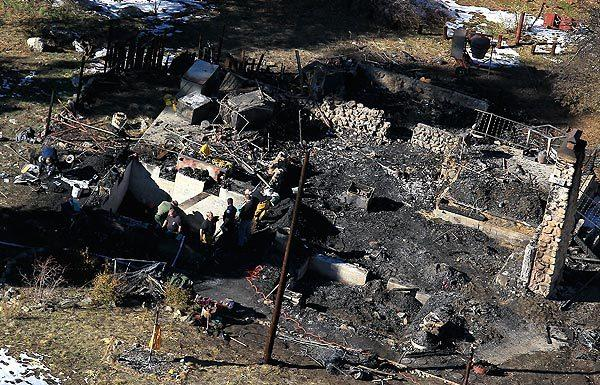 Investigators have found personal items of fugitive ex-police officer Christopher Dorner inside the rubble of the burned cabin where they found human remains, those in law enforcement with knowledge of the case said.