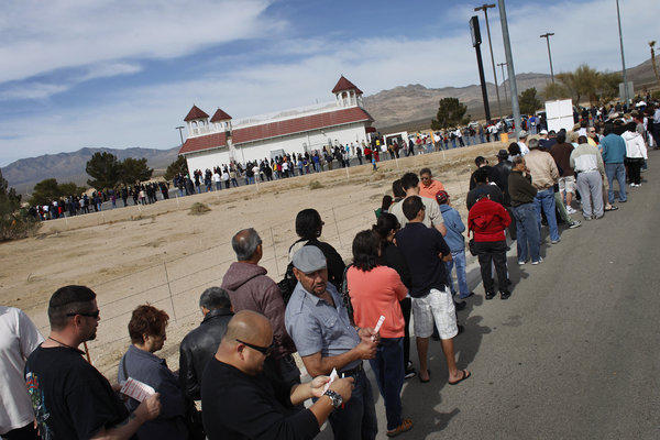 Thousands of people wait in line Thursday to buy tickets for the Mega Millions lottery jackpot at the Primm Valley Casino Resorts Lotto store in California near Primm, Nev.