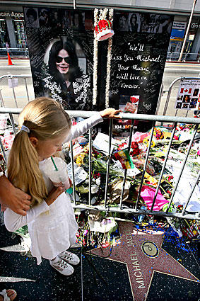 A young fan visits Michael Jackson's  star on the Hollywood Walk of Fame.