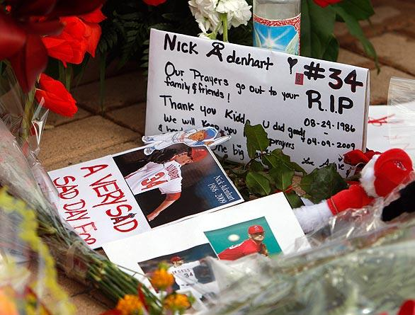 Notes, flowers, candles and cards left in tribute to Nick Ardenhart.