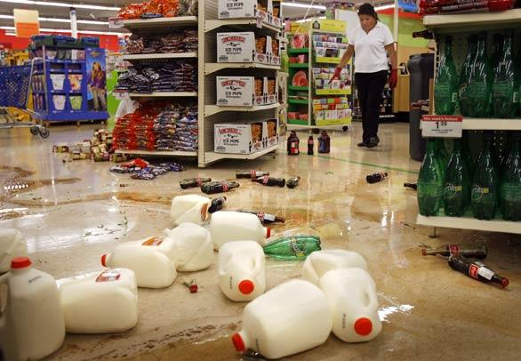 Milk jugs and other merchandise litter the aisles at a Kmart in Diamond Bar. (An earlier version of this caption said the Kmart was in Chino Hills.)