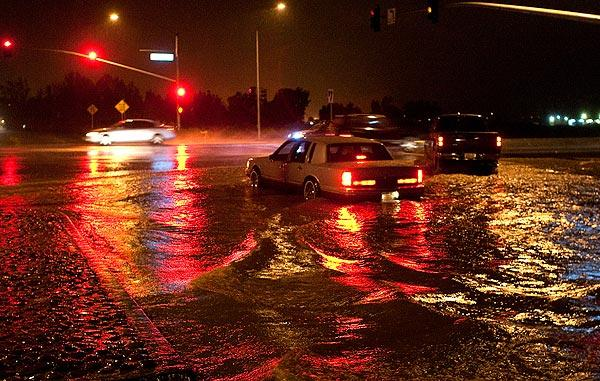 Traffic lights are reflected in floodwaters on  Indiana Avenue at the Ramona Expressway during heavy rains.