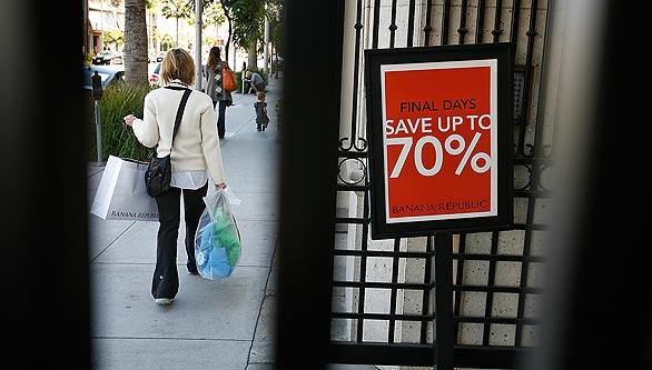 A Banana Republic store on Beverly Drive offers up to 70 percent savings in the store. Wealthy cities such as Beverly Hills, Santa Monica and Newport Beach prepare to cut spending as revenues decline.