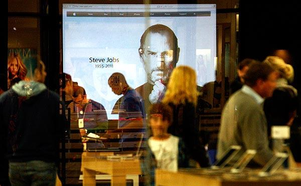 An image of Steve Jobs is projected inside the Apple Store in Santa Monica.