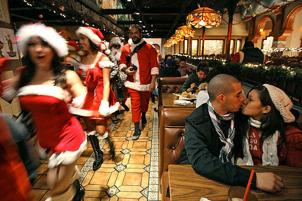 Not even a mob of revelers in Santa costumes could interrupt a couple in love at Restaurant El Tarasco in Los Angeles. The Santas were celebrating SantaCon 2009.