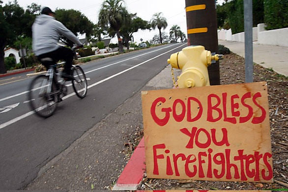 A sign made by Debbie Trauntvein and her son Evan offering their gratitude is displayed at a fire hydrant on State Street.