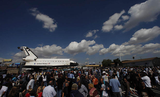People crowd in front of the space shuttle Endeavour parked in a  Westchester shopping center.