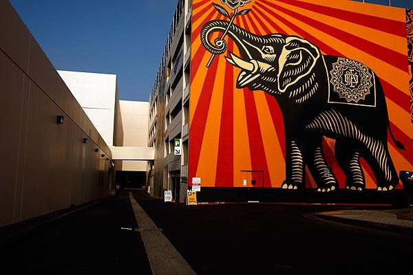 "A mural by artist Shepard Fairey titled ""Peace Elephant"" graces the west wall of a parking structure at the new West Hollywood Library.<br> <br> <br>