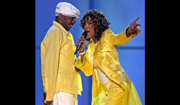 "Whitney Houston and then-husband Bobby Brown perform in the ""VH1 Divas"" duets show in Las Vegas."