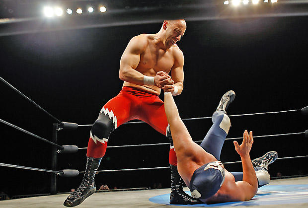 Lucha Libre USA wrestler RJ Brewer, left, battles Blue Demon Jr. in the ring at Stockton Arena.  Brewer, 32, whose real name is John Stagikas, plays an anti-illegal immigration bad guy whom the largely Mexican crowds love to jeer.