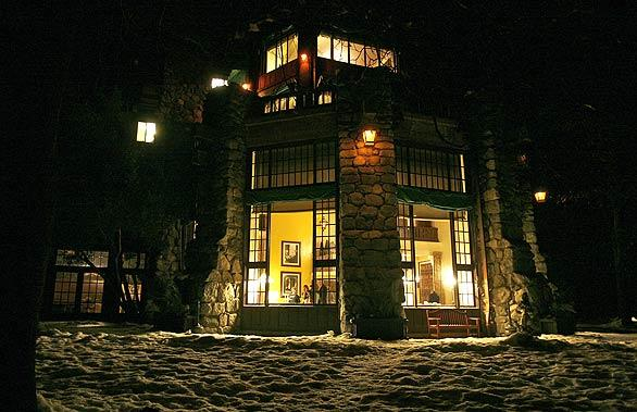 Light from a dining room at Yosemite's Ahwahnee Hotel glows on the snow-covered ground outside. The park's 6,816 CCC enrollees built walls and buildings using rocks and trees. Those projects remain in the park today and help create Yosemite's rustic look.