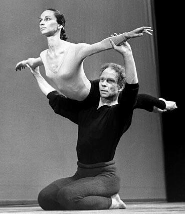 Merce Cunningham lifts Carolyn Brown during rehearsal at the Sadler Wells Theater in London in 1964.