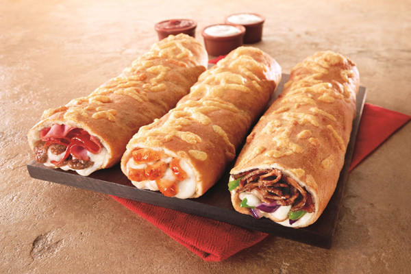 "Pizza Hut's new product comes in Meat Trio, Italian Steak and Buffalo Chicken and looks like a cross between a sub, a roll and a Costco-style chicken bake.<br /><br />Read more on Pizza Hut's <a href=""http://latimesblogs.latimes.com/money_co/2011/12/wendys-japan-foie-gras-truffle-burger.html"" target=""_blank"">grab for Subway's market share</a>."