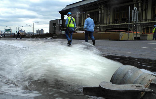 Water is pumped out of a subway station in Lower Manhattan near Battery Park.
