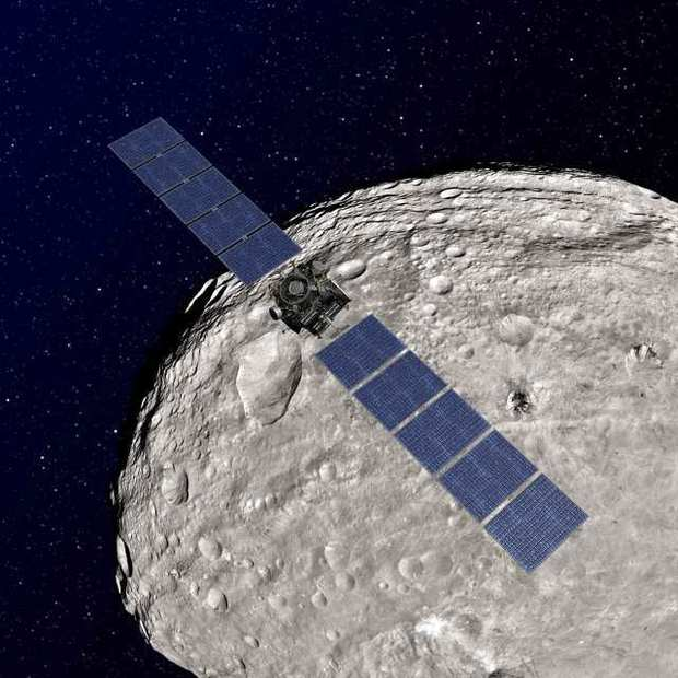 "Dawn is leaving the giant asteroid Vesta, shown in an artist's rendering, and heading toward another object, a dwarf planet named Ceres.  <br><b>More: </b><a href=""http://www.latimes.com/news/nation/nationnow/la-na-nn-name-asteroid-20120905,0,7366583.story"" target=""_blank"">NASA sets its sights on a new asteroid and wants to bring a piece home</a>"