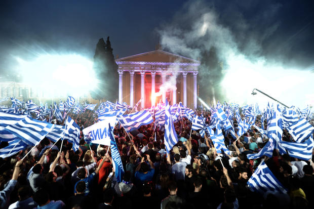 Supporters of the leader of the Greek conservative party New Democracy, Antonis Samaras, wave flags during an election speech in Athens.