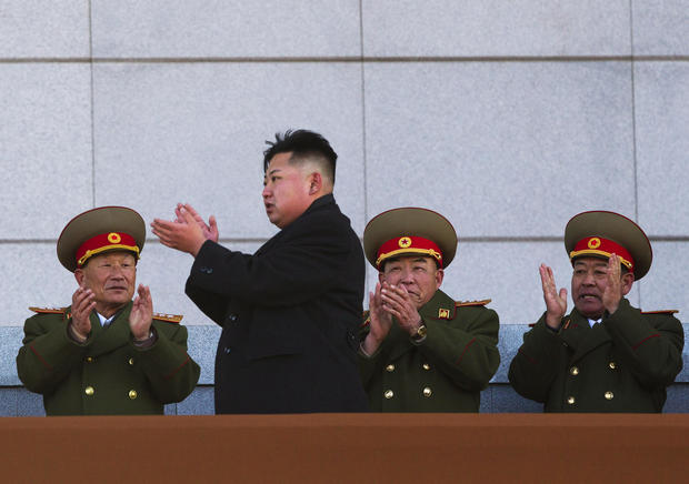 New North Korean leader Kim Jong Un, second from left, applauds as he leaves the stands at Kumsusan Memorial Palace in Pyongyang.
