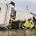 Firefighters rescue trucker