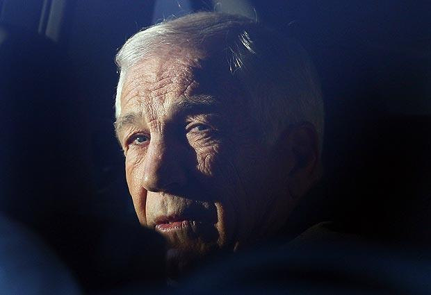 Former Penn State assistant football coach Jerry Sandusky sits in a car while leaving the Centre County Courthouse, on Tuesday in Bellefonte, Pa.