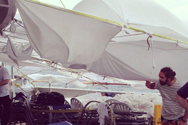 An Instagram photo provided by a passenger of the Carnival Cruise Ship Triumph identifying himself as Clarkaj shows the tents made of bed sheets at the deck of the ship as it is towed by tug vessels toward Mobile, Alabama.