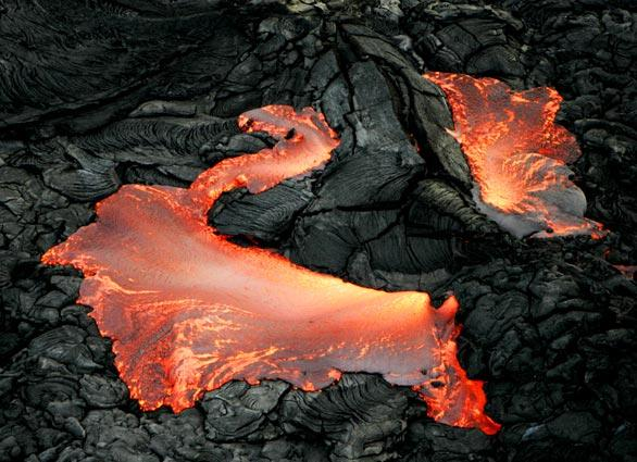 Kilauea has been erupting for 25 years. This image was captured by helicopter from 500 feet above a lava flow as it broke through the surface from the volcano's Pu'u 'O'o Crater.