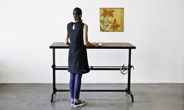 "For a handcrafted take on the idea: The Adler table from Ohio Design in San Francisco has a crank made from steel gears and a chromed, cast-iron handle. The work surface shifts from 27 to 42 inches high and can be ordered in a variety of woods, including walnut, oak and maple. Power-coated steel legs are available in ""practically any color."" It's $1,925. <a href=""http://www.ohiodesign.com"">www.ohiodesign.com</a>"