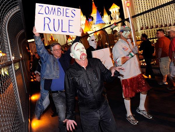 "Occupy Las Vegas members participate in a ""zombie walk"" on the Las Vegas Strip to protest what they consider greed and corruption among banking and business leaders in solidarity with other Occupy movements around the world."