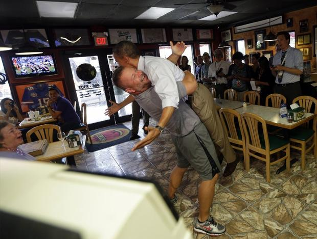 "Usually it's the president who initiates the hugging -- there must be an etiquette rule on this somewhere -- but in this case it was Ft. Pierce, Fla., pizza place owner Scott Van Duzer who did the full grip and lift on Sept. 9. Van Duzer said anti-Obama people began boycotting his pizza restaurant after the hug pic went viral.  <br><br> <p><strong>ALSO:</strong></p> <p><a href="" http://www.latimes.com/news/opinion/la-ol-joe-biden-on-the-campaign-trail-20120918,0,1756781.photogallery""><strong>PHOTOS:</strong> Joe Biden wants to hug ... everyone!</a></p>"