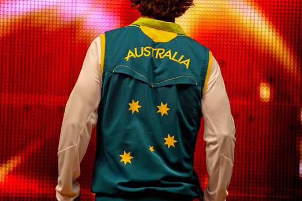 Australian Olympic canoer Kynan Maley models a team uniform.