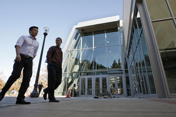 Students walk past an entrance to the freshly renovated Pauley Pavilion on the UCLA campus.