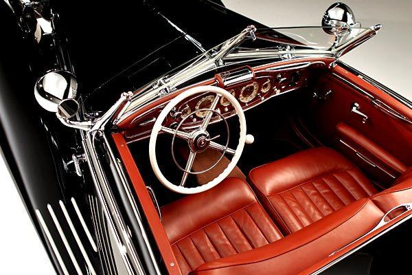 The car oozes elegance. The interior is brown leather, wood and chrome. Fenders cover the front wheels and then undulate downward under the doors to serve as a footstep. A chromed Mercedes star ornament rises from the top of the hood, and a tiny Von Krieger family crest is painted on the driver's door.