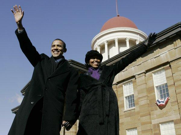 Then-Sen. Barack Obama, (D-Ill.), and his wife Michelle wave to the crowd after he announced his candidacy for president of the United States at the Old State Capitol in Springfield, Ill.