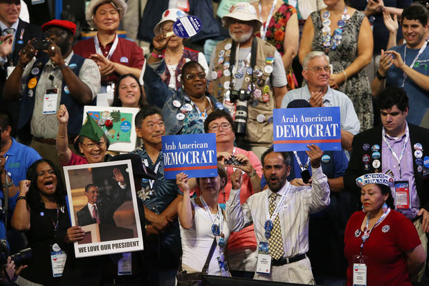 People hold campaign signs as the program starts during day one of the Democratic National Convention in Charlotte, N.C.