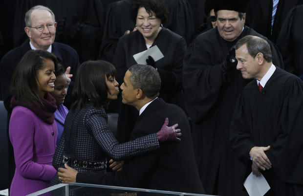 President Barack Obama kisses his wife, Michelle, after the ceremonial swearing-in at the U.S. Capitol.