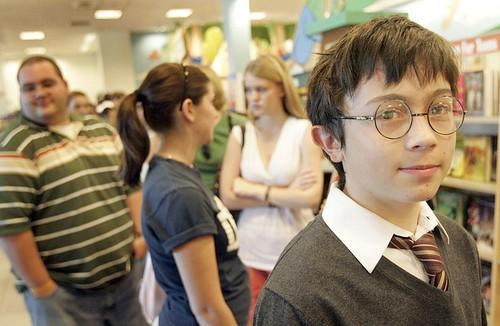 Frankie Mezzatesta, 12, in Harry Porter costume stands in line at Barnes & Noble in the Glendale Fashion Square.