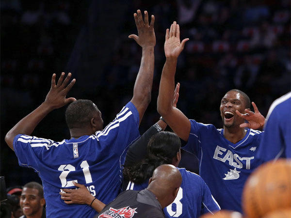 Miami's Chris Bosh, right, celebrates with former NBA player Dominique Wilkins after their team won the shooting stars competition Saturday night as part of the All-Star weekend festivities in Houston.