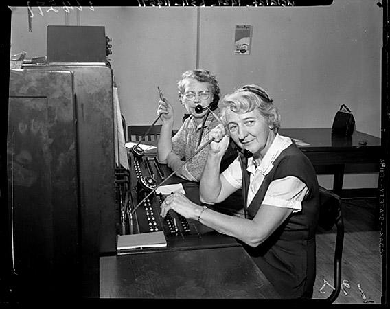 Operators Grace Miller, left, and Theresa Vincent at the switchboard of Los Angeles' Air Pollution Control District office in 1959.