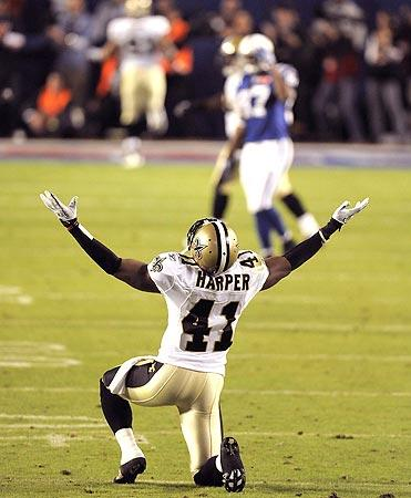New Orleans Saints safety Roman Harper celebrates after teammate Tracy Porter's interception return in the fourth quarter in Super Bowl XLIV at Sun Life Stadium in Miami Gardens, Fla. New Orleans defeated the Indianapolis Colts, 31-17, for the Saints' first Super Bowl victory.