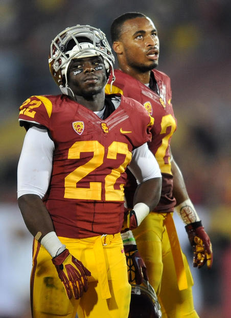 USC running back Curtis McNeal (22) and receiver Robert Woods can only watch late in the fourth quarter as Oregon drives for another touchdown.