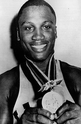 Joe Frazier displays the gold medal he won at the 1964 Olympics, where he defeated Han Huber of Germany in the finals.