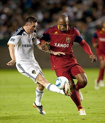 Galaxy forward Robbie Keane keeps control of the ball against Real Salt Lake defender Jamison Olave before scoring in the second half of a 3-1 victory on Sunday at Home Depot Center.