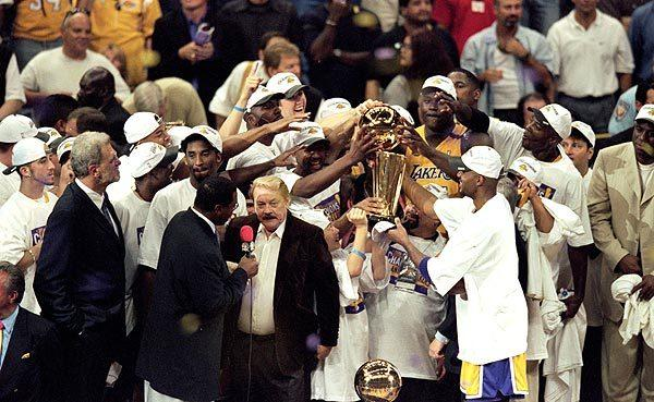 Lakers owner Jerry Buss is interviewed after his team defeated the Indiana Pacers in six games to win the 2000 NBA championship.