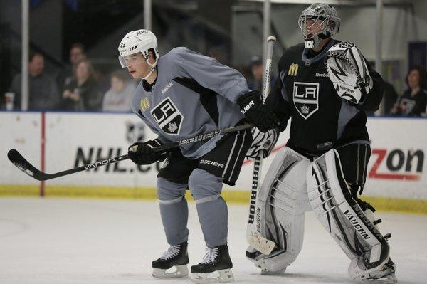 Kings stars Dustin Brown, left, and goalie Jonathan Quick participate in drills during the the team's first practice of the 2013 NHL season at the Toyota Sports Complex.