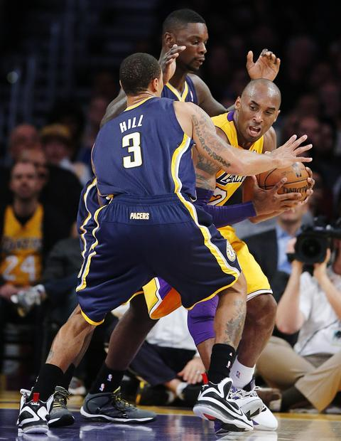 Kobe Bryant  is defended by Indiana Pacers' George Hill and Lance Stephenson in the first half on Tuesday.