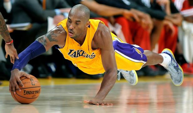 Kobe Bryant dives for a loose ball against the Bucks during the Lakers' 104-88 victory over Milwaukee.