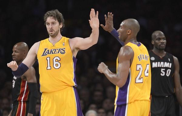 Pau Gasol is congratulated by teammate Kobe Bryant after scoring during the first half against the Miami Heat on Thursday.