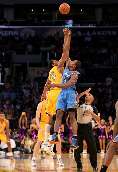 Andrew Bynum and Serge Ibaka leap for the opening jump ball to start Game 4.