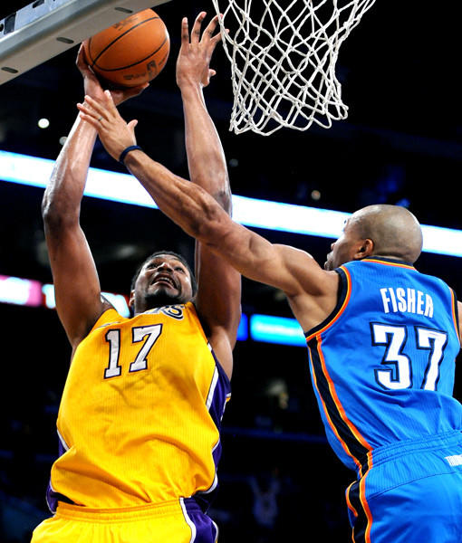 Andrew Bynum makes a basket over Derek Fisher in the first half of Game 4.