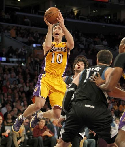 Steve Nash finds a hole in the Minnesota defense during the Lakers' matchup with the Timberwolves on Thursday at Staples Center.
