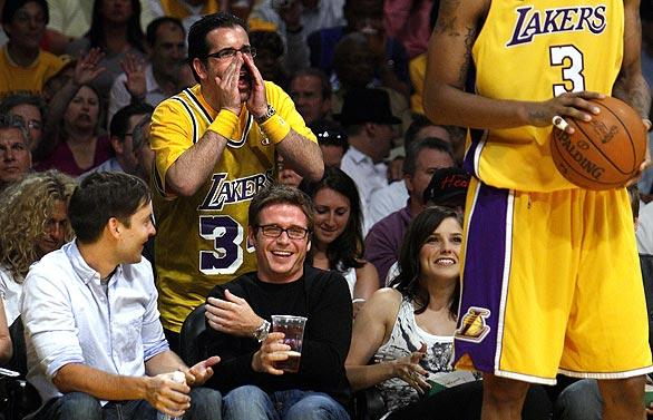 Actors Tobey Maguire, Kevin Connolly and Sophia Bush laugh courtside during Game 1 of the NBA Finals at Staples Center.